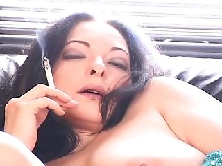 Curvy Solo Black-haired With Big Tits In A G-string Smoking While Masturbating On Sofa