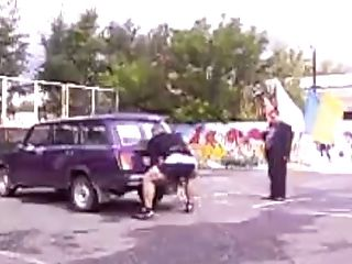 Two Muscular Euro Folks Lifting Cars