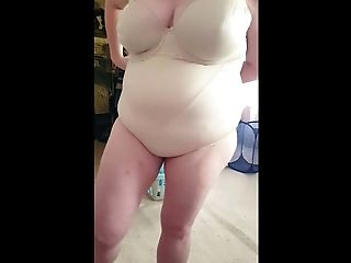 Squeezing Into Her Taut Girdle, Big Tits