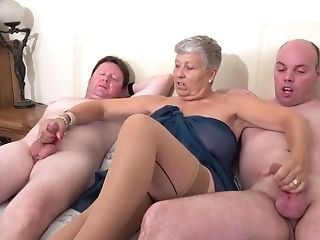 Granny Savana Strokes Two Thick Dicks Of Horny Cranks